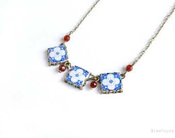 Assunçao. VIntage patterned tile necklace. Necklace with art nouveau ceramic tile pattern. Blue, white and red