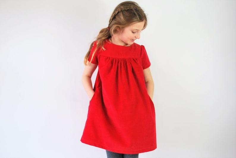Girlsr red corduroy dress. pocket pinafore. Christmas jumper. image 0
