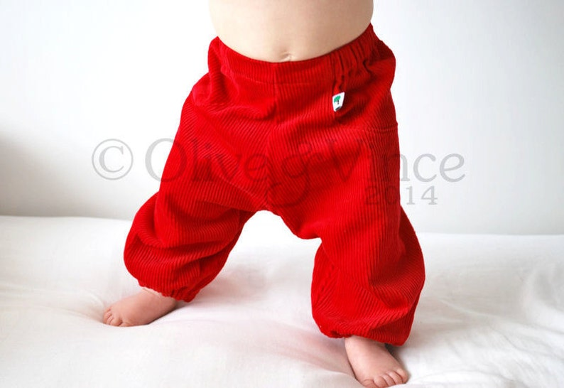 Red corduroy harem trousers. Christmas pants. Childrens baggy image 0