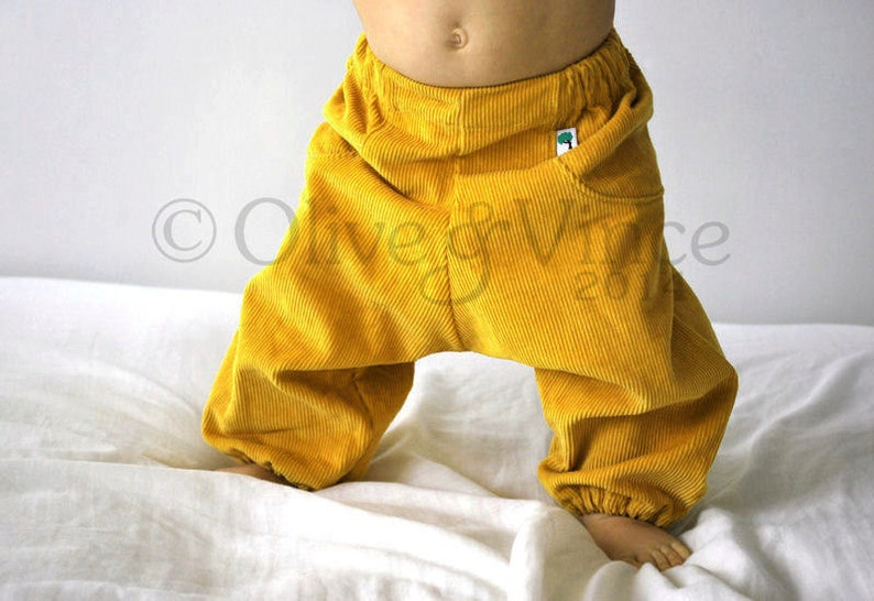 Kids yellow trousers. Boys girls pants. Easter Spring. Cotton image 0