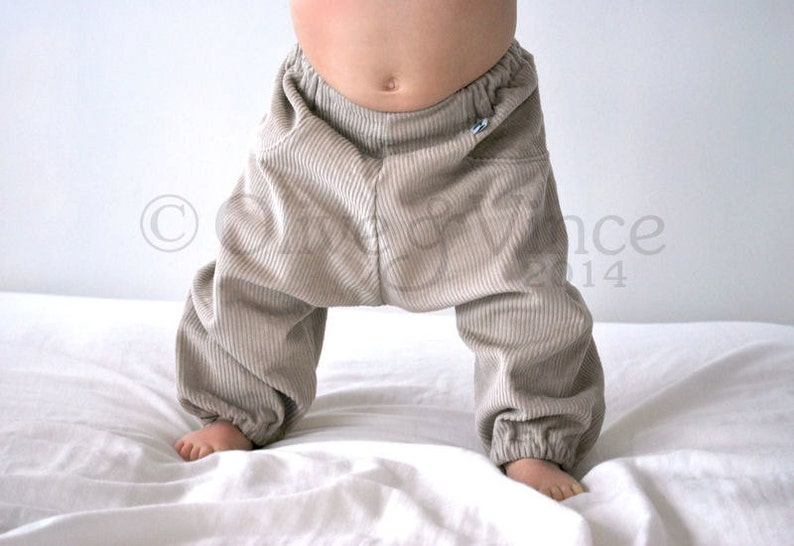 Kids baggy trousers. beige cream pants. slouchies. natural image 0
