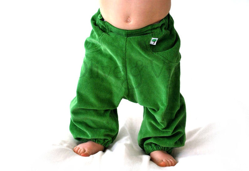 Kids green pants. girls boys trousers. childrens spring image 0