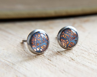 Dusty blue and rose gold ear studs in 316L steel settings