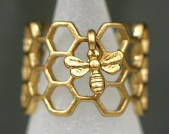 Honeycomb Ring with tiny bee. Antique golden enameled. Adjustable hexagon ring. Modern nature jewelry for her.