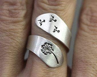 Hand stamped sterling dandelion ring. Wrap around ring, handstamped with dandelion and dandelion seeds. Adjustable.