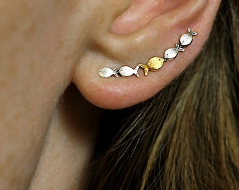 Against the current ear climbers. Dainty. School of fish with one golden enameled swimming upstream. Gift for her.