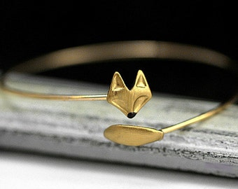 Delicate hand gilded fox bangle. Fox and tail, hand gilded and enameled. Adjustable wrap bangle.