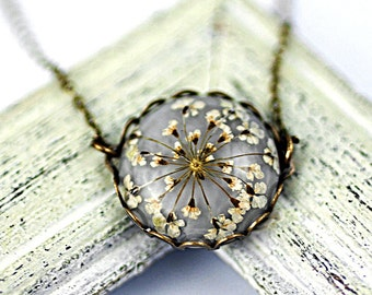 Small romantic necklace with real dried queen anne's lace in light grey and bronze lace setting