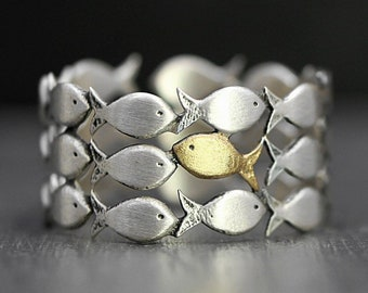 Swimming Against The Current. Sterling adjustable ring. School of fish with one golden enameled fish swimming upstream. Gift for HER and HIM