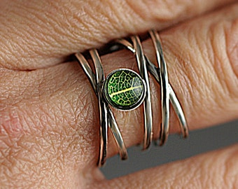 Sterling Silver ring with real leaf. Multiple bands with tiny leaf in resin and glass. Adjustable. Nature inspired gift for her.