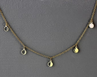 Moon Phase necklace. Dainty with waning moon discs and glass opal. 18k gold plated sterling.