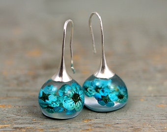 Real blossom earrings. Turquoise real flowers in resin spheres. Silver ox earwires. Big earrings. Gift for her.