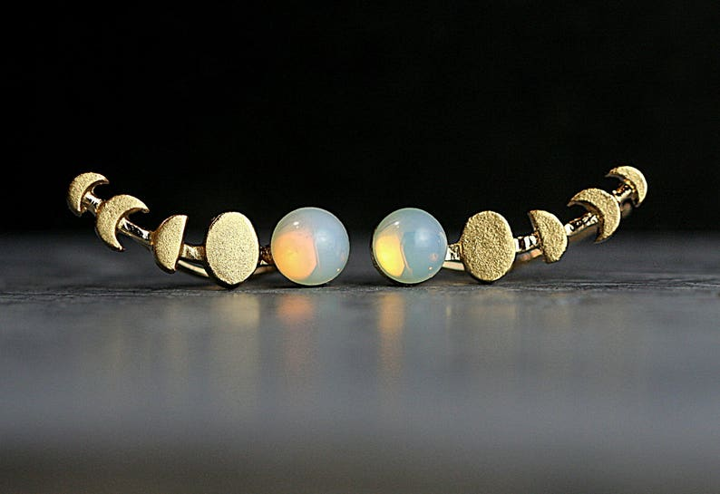 Moon Phase ear climbers. Ear crawler with vintage opal. Hand image 0