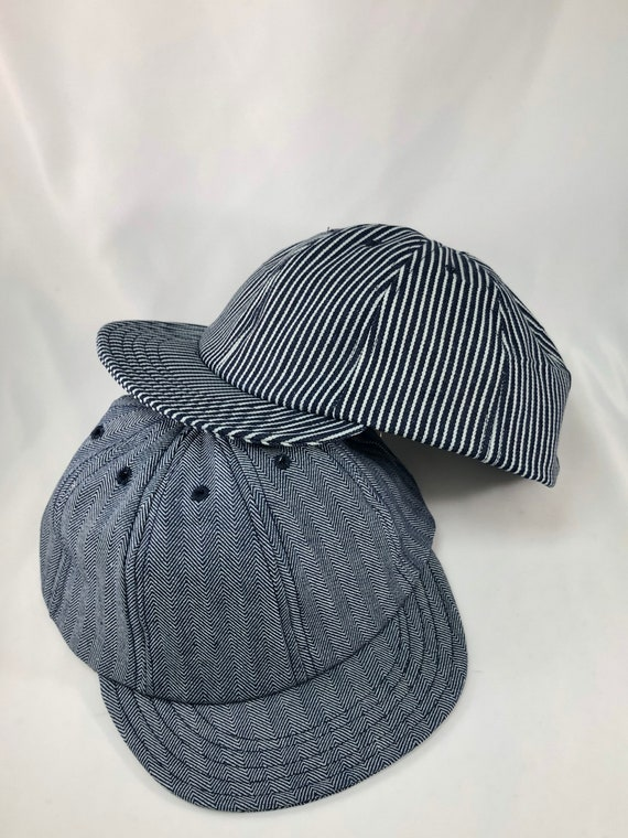 Herringbone or hickory stripe denim eight panel caps. Short visor. Absolutely any size.