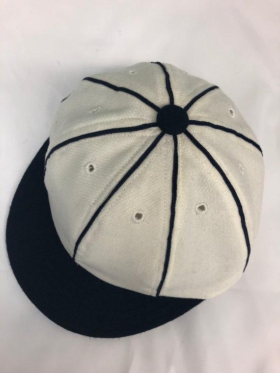 Detroit Vintage Base Ball 1859 Team cap. White wool flannel 8 panel with large button, soutache, and short soft visor.