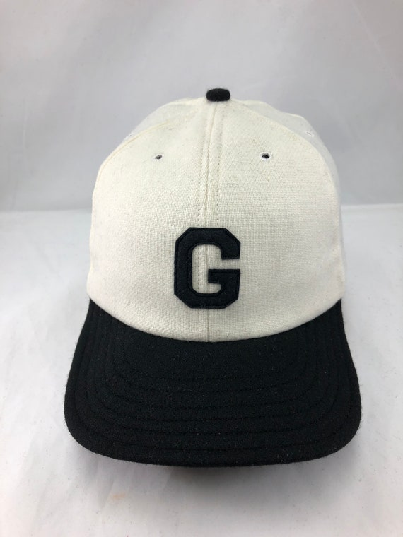 White wool flannel 6 panel cap,  black 2 1/2 in. visor. Hand cut Black G felt logo. Custom hat, Made to order, fitted, any size available.