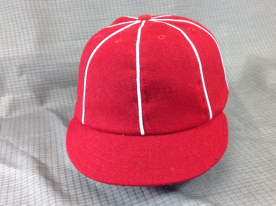 Red wool flannel 8 panel cap with short 1910 visor, white soutache on seams. Custom made in any size.