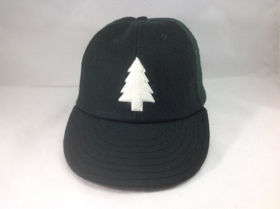 Felt Pine tree logo on wool flannel cap. Chose cap color and size at checkout! Hand crafted to order.