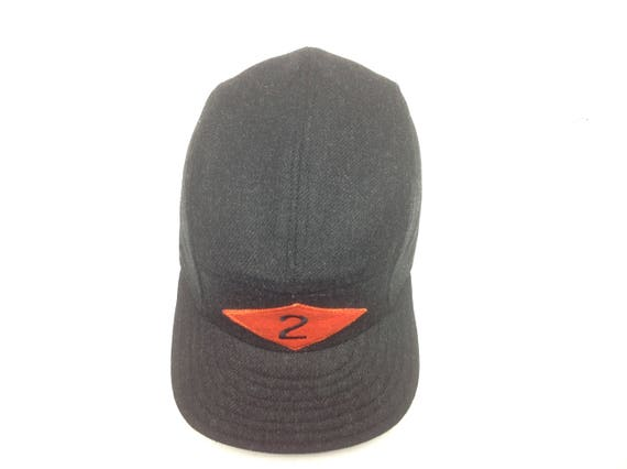 Charcoal wool flannel 5 panel cap with embroidery on wool felt patch. Any felt color and number. Fitted to any size!