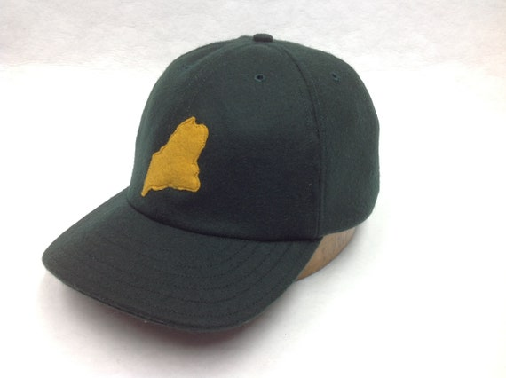 Dark Green 6 panel wool cap with felt state of Maine logo, hand cut and stitched, 2.5 inch visor.  Any size available.