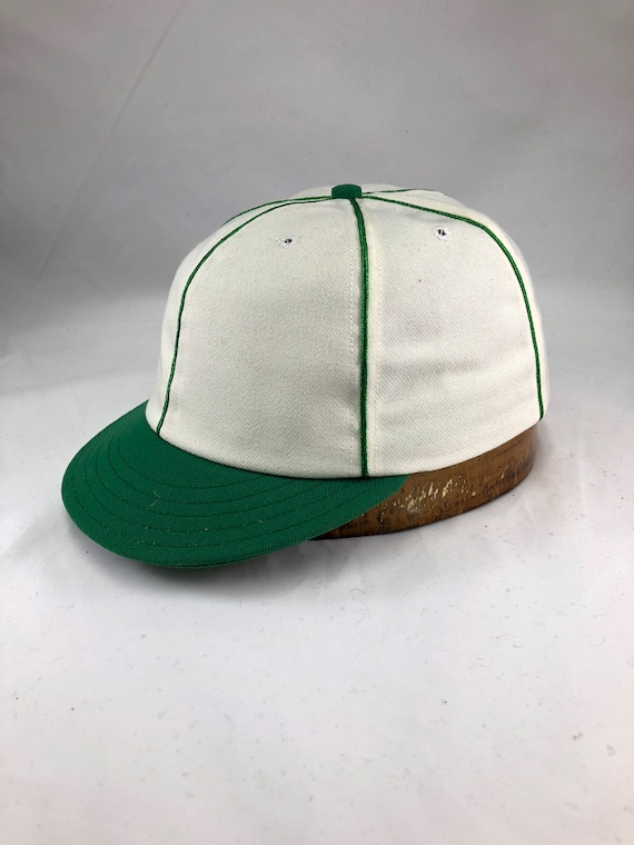 Crest Highlanders Vintage Base Ball cap. Custom made 6 panel cap in white wool serge, Kelly green short visor, button and soutache