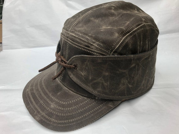Combat the weather in this waxed cotton 5 panel with front pockets, neck/ear cover.