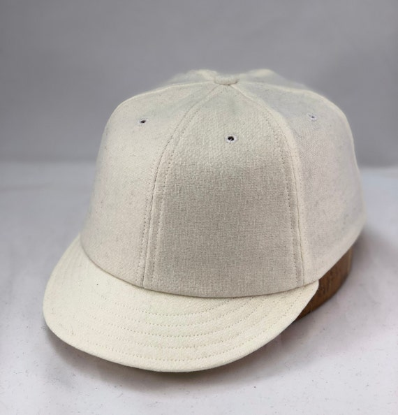 "White wool flannel 6 panel cap with 2"" visor. Custom made to order, Fitted to any size."