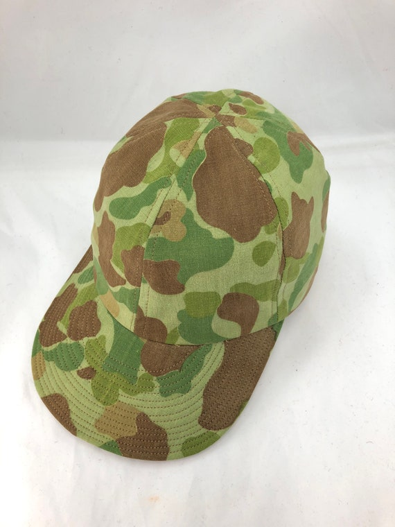 Genuine WWII Marine Corps shelter tent material has been repurposed into A-3 style caps with flexible visor.