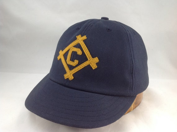 Navy cotton twill 6 panel ballcap with gold felt framed letter. Any initial available, any size cap. Hand crafted to order. Made in USA