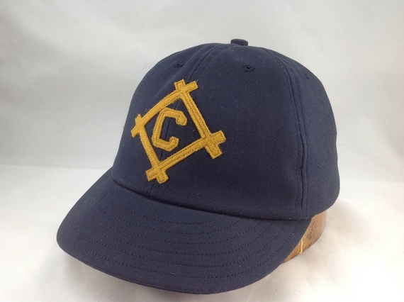 Navy cotton twill 6 panel ballcap with gold felt framed C. Any initial available, any size cap. Hand crafted to order. Made in USA