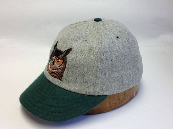 "6 panel light grey wool flannel ballcap with owl embroidery, 2"" green visor, cotton sweatband, custom colors and cap sizes."