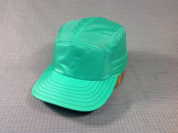 Ripstop nylon 5 panel custom made cap. Kelly Green with cotton sweatband. Leather sweatband available upon request.