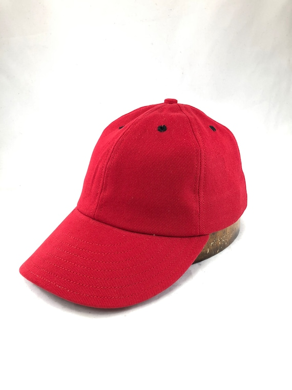"Red cotton twill 6 panel cap with black eyelets, 3"" visor and cotton sweatband. Fitted to any size. Select at checkout."