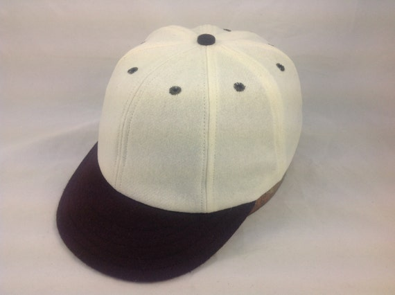 Custom made 8 panel Baseball cap. White wool flannel with brown 1920's visor, fitted with brushed cotton sweatband.