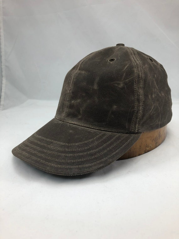 Brown Waxed cotton 6 panel cap. 3 inch visor. Classic style in a custom made cap. Any size available.