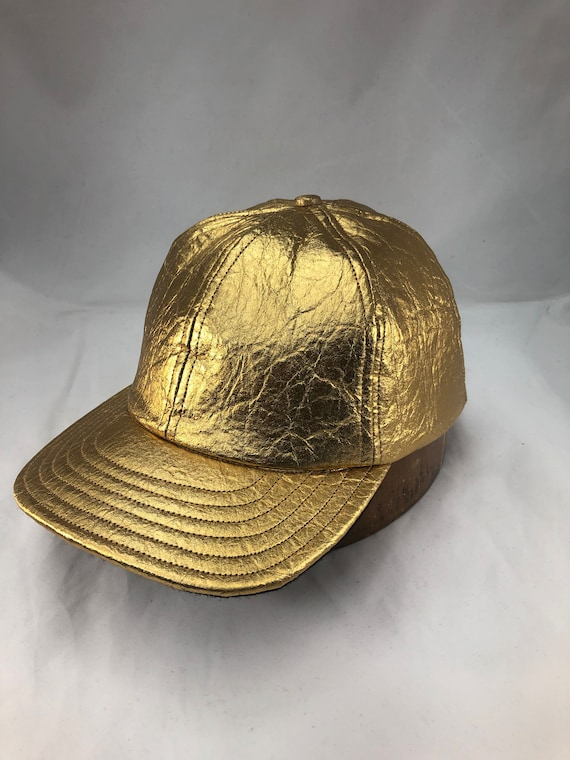 Pineapple fiber leather in gold is  custom made into a 6 panel cap and available in any size. Limited quantity available.