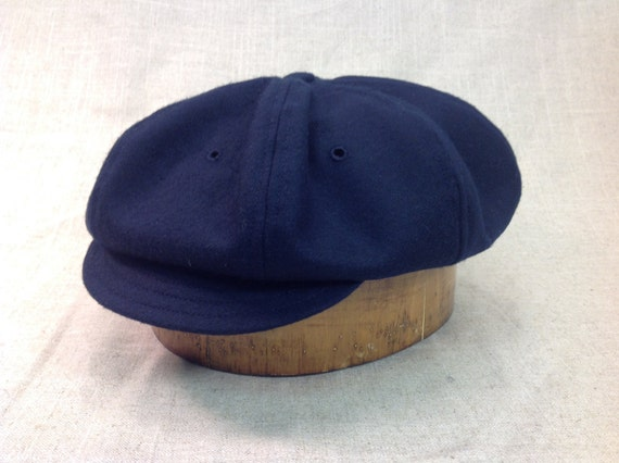 Hand crafted, navy melton wool 8 panel baggy cap, long or short visor, adjustable or fitted with cotton or leather sweatband.