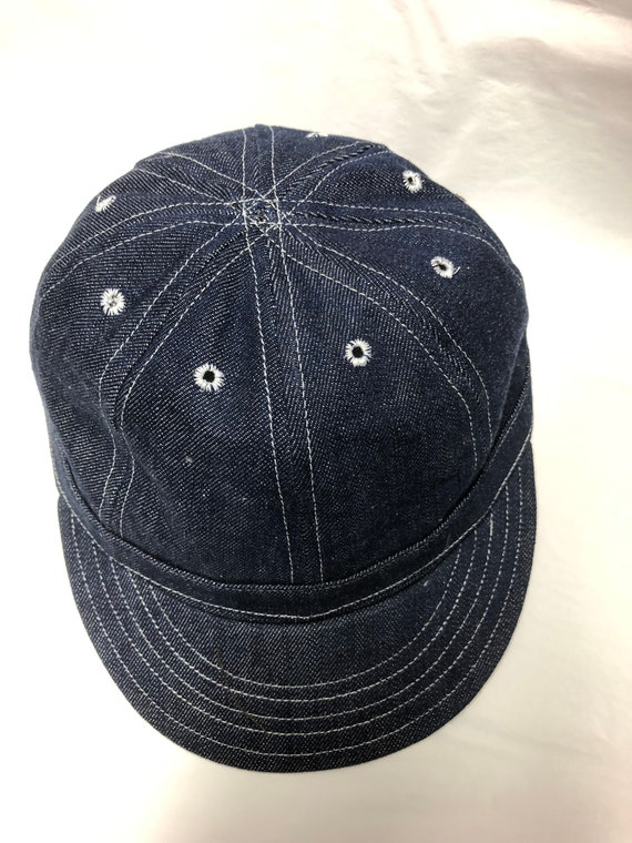 8 panel mechanics cap in indigo denim, soft visor, white topstitching, eyelets, no button. Any size available, fitted or adjustable.