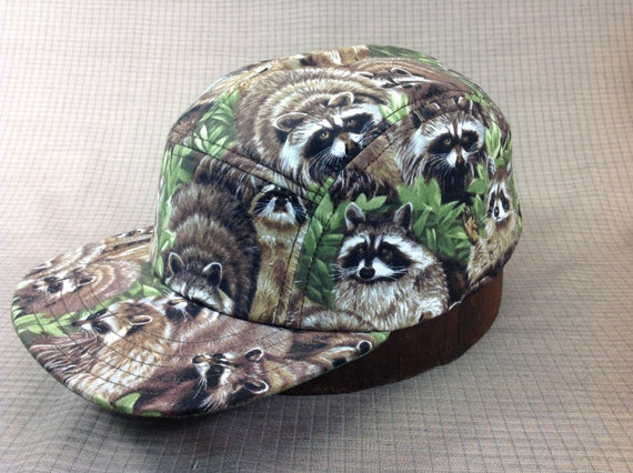 Hand made 5 panel cap in Raccoon print cotton lined, cotton sweatband, adjustable. One size fits most.