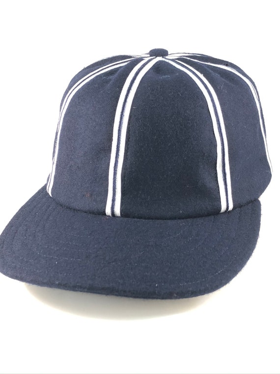 "Navy wool 8 panel cap with white and navy braid trim on seams. Leather sweatband, any size. Vintage shallow design cap. 2 1/2"" inch visor."