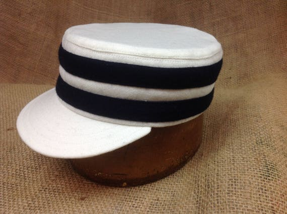 Shallow crown box cap. White wool flannel with navy wool bands. Fitted to any size, any color combination available!
