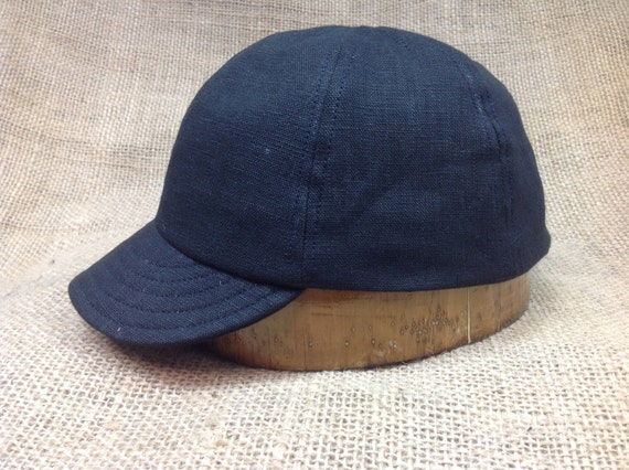 "European Linen black (or Natural color)  6 panel cap with short flexible 2"" visor, cotton sweatband."