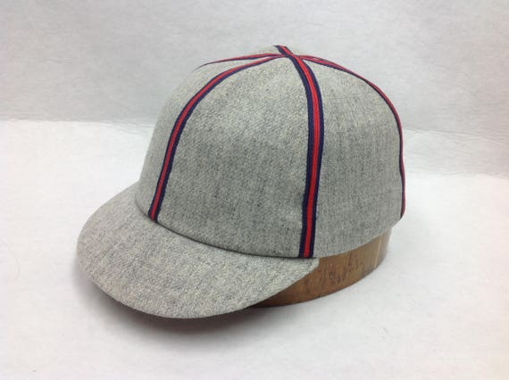 Fitted baseball cap in soft light grey wool flannel with red/blue braid. 19th century 2 inch era visor style. All sizes available.