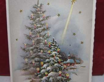 Pretty 1950's gold gilded Continental Import christmas card snow covered trees decorated with candles church in distance