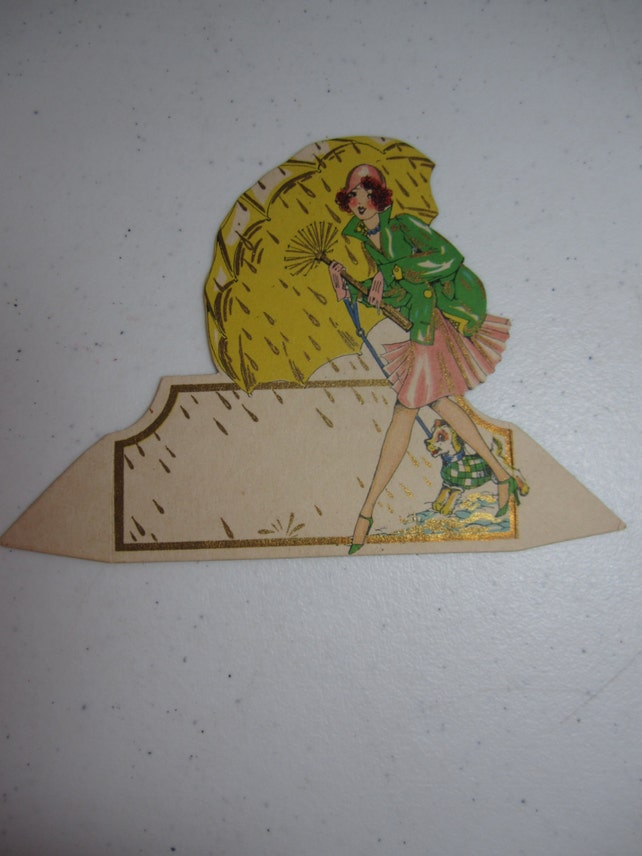 Gorgeous die cut gold gilded unused 1920's-30's Hallmark art deco place card deco lady holding huge umbrella in rain w/ cute dog on a leash