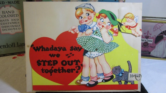 1930's unused very  Large die cut mechanical Carrington  Valentine cupid and adorable kitten following rosy cheeked  boy and girl walking