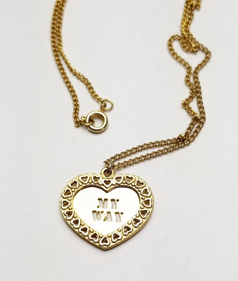 MY WAY Gold Heart Pendant Trimmed in Tiny Hearts Golden image 0