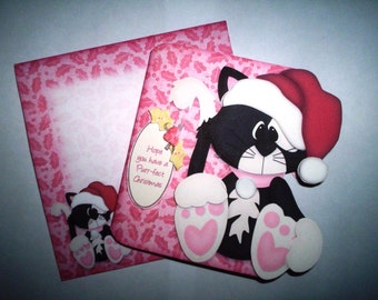 Hand cut and layered Christmas card of a little Santa kitty with matching envelope.