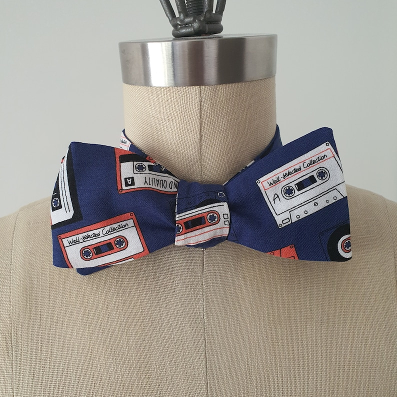 Self-tie and pre-tie bow tie cassette tapes on deep blue retro print*