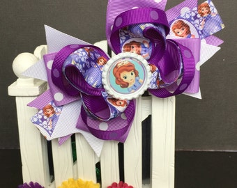 Sofia the first Hair Bow ~ Cute bow for babies, toddlers and big girls ~ Bow measures approximately 5.5 inches